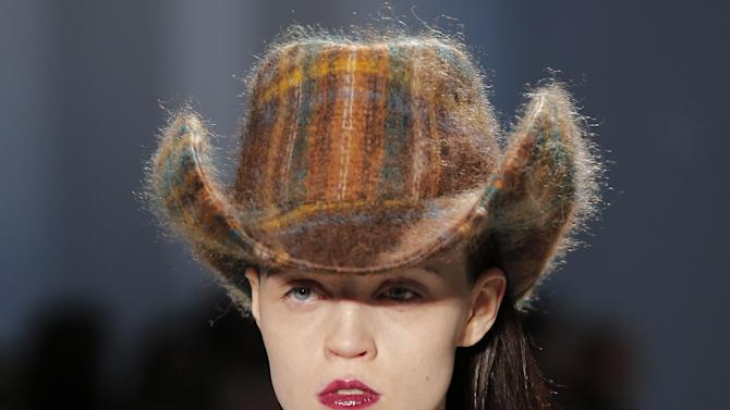 A model wears a creation by Belgian born fashion designer Veronique Branquinho as part of the Ready to wear Fall/Winter 2013/2014 fashion collection presented in Paris, Tuesday, Feb. 26 2013. (AP Photo/ Jacques Brinon)