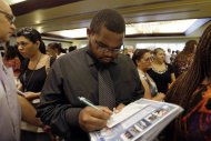 <p> In this Wednesday, Aug., 14, 2013, photo, job seeker Kelsey Devoe, of Miramar, Fla., fills out a contact form at a job fair in Miami Lakes, Fla. The Labor Department reports on the number of Americans who applied for unemployment benefits last week on Thursday, Aug. 15, 2013. (AP Photo/Alan Diaz)