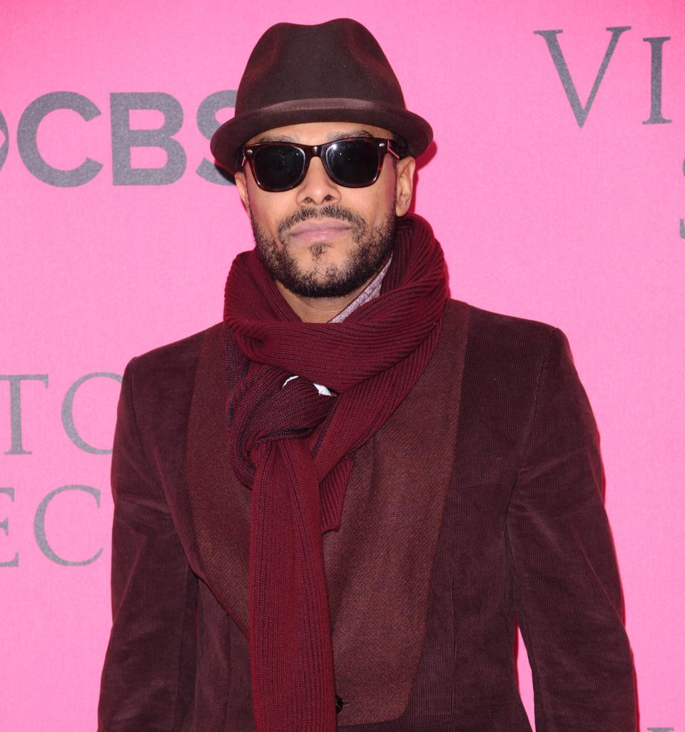 FILE - In this November 9, 2011 file photo, Maxwell attends the Victoria's Secret fashion show in New York. The R&B singer canceled his six-date 2012 summer tour after developing a definitive vocal cord edema and a vocal cord hemorrhage. (AP Photo/Peter Kramer, File)