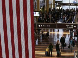 Thanksgiving Eve travelers walk down the Reagan National Airport main concourse in Washington