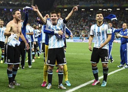 Argentina's Messi celebrates with teammates Rodriguez and Aguero their win over the Netherlands during their 2014 World Cup semi-finals at the Corinthians arena in Sao Paulo