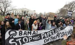 File photo shows environmentalists rallying and calling on U.S. President Barack Obama to reject the Keystone XL pipeline