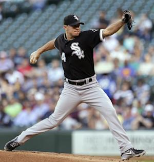 Chicago White Sox starting pitcher Jake Peavy throws against the Seattle Mariners in the first inning of a baseball game Tuesday, June 4, 2013, in Seattle. (AP Photo/Elaine Thompson)