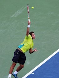 Stanislas Wawrinka of Switzerland serves against Roger Federer of Switzerland. Federer won 7-6 (7/4), 6-3
