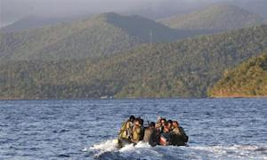 Members of Philippine marines are transported on rubber boat from patrol ship after conducting mission on disputed Second Thomas Shoal as they make way to naval forces camp in Palawan