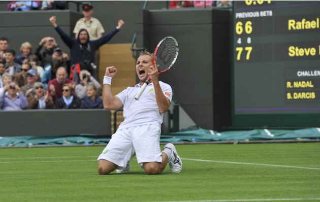 Steve Darcis of Belgium celebrates after defeating Rafael Nadal of Spain in their men's singles tennis match at the Wimbledon Tennis Championships, in London