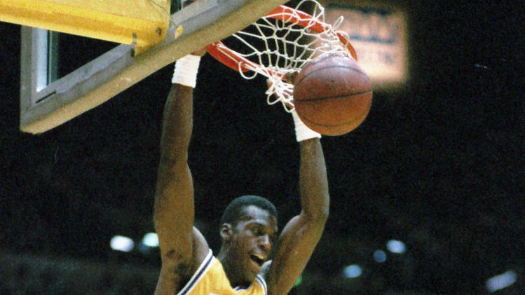 FILE - This May 1, 1989 file photo shows Los Angeles Lakers' Orlando Woolridge dunking over Portland's Kevin Duckworth during an NBA game in Inglewood, Calif.  Former NBA standout Orlando Woolridge has died at his parents' home in Mansfield, La. He was 52. DeSoto Parish Chief Deputy Coroner Billy Locke said Woolridge died Thursday night, May 31, 2012. He had been under hospice care for a chronic heart condition.  (AP Photo/Douglas Pizac, File)