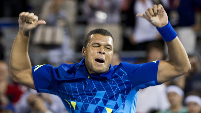 Jo-Wilfried Tsonga, from France, celebrates his 7-6 (3), 4-6, 6-1 victory over Roger Federer, from Switzerland, at the Rogers Cup tennis tournament Thursday, Aug. 11, 2011, in Montreal. (AP Photo/The Canadian Press, Paul Chiasson)