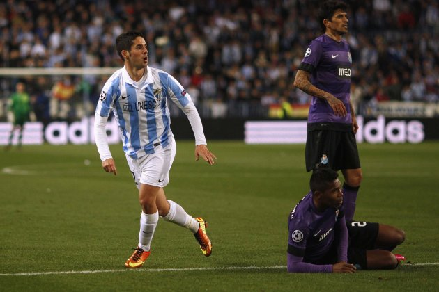 Malaga's Isco scores a goal past Porto's Lucho Gonzalez and Alex Sandro during their Champions League soccer match in Malaga