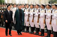 Chinese President Hu Jintao (L) and Afghan President Hamid Karzai at the Great Hall of the People in Beijing in June. Karzai&#39;s office said Zhou Yongkang came to Afghanistan to discuss the implementation of a strategic cooperation agreement that Karzai signed with Hu in June