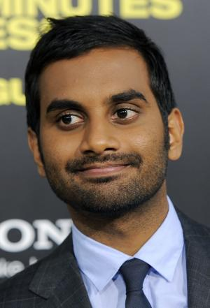 "FILE - In this Aug. 8, 2011 file photo, Aziz Ansari, a cast member in ""30 Minutes or Less,"" poses at the premiere of the film in Los Angeles. On Monday, April 2, 2012, the actor and comedian helped New York City's Central Park get ready for spring by lending a hand mowing its 15-acre Sheep Meadow on a riding lawn mower. Ansari was assisted by several park crew members, also riding lawn mowers. (AP Photo/Chris Pizzello, File)"