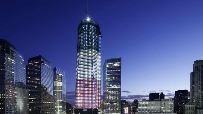 One World Trade Center overlooks the ground zero memorial site, Saturday, Sept. 10, 2011, in New York. Ceremonies will be held at the site Sunday for the 10th anniversary of the September 11 attacks. (AP Photo/Mark Lennihan)