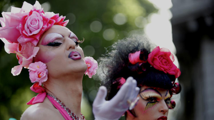 A transvestite blows a kiss before the Gay Pride Parade in Buenos Aires, Argentina, Saturday, Nov. 6, 2010. (AP Photo/Natacha Pisarenko)