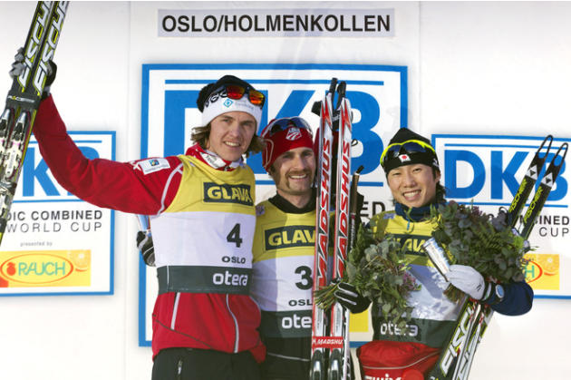Winner Bryan Fletcher (C) Of The U.S. Celebrates On The Podium With Second Placed Mikko Kokslien (L) Of Norway And AFP/Getty Images