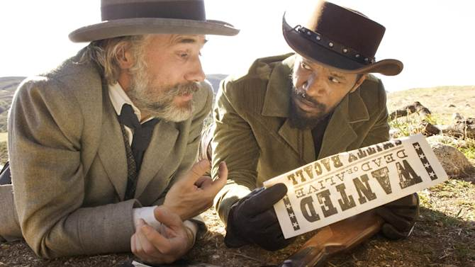 """This undated publicity image released by The Weinstein Company shows, Christoph Waltz as Schultz, left, and Jamie Foxx as Django in the film, """"Django Unchained,"""" directed by Quentin Tarantino. Foxx says Hollywood should take some responsibility for tragedies such as the deadly school shooting in Connecticut on Friday, Dec. 14, 2012. In an interview Saturday, Dec. 15, 2012, Foxx said actors cannot """"turn their back"""" on that fact that movie violence can """"influence"""" people. (AP Photo/The Weinstein Company, Andrew Cooper, SMPSP)"""