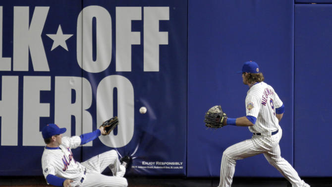 New York Mets' Jason Bay, left, and Kirk Nieuwenhuis try to field a triple by San Francisco Giants' Nate Schierholtz during the first inning of the second baseball game of a doubleheader, Monday, April 23, 2012, in New York. (AP Photo/Seth Wenig)