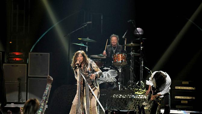 Steven Tyler, left, and Joe Perry, of musical group Aerosmith, perform onstage at the American Idol Finale on Wednesday, May 23, 2012 in Los Angeles. (Photo by John Shearer/Invision/AP)
