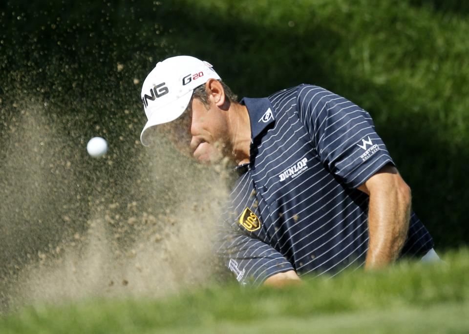 Lee Westwood, of England, hits out of the bunker on the ninth green during the final round of the BMW Championship PGA golf tournament at Crooked Stick Golf Club in Carmel, Ind., Sunday, Sept. 9, 2012. (AP Photo/Charles Rex Arbogast)