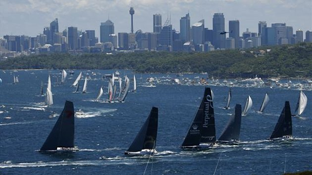 The field of yachts led by Wild Oats XI (L), Beau Geste (2nd L) and Perpetual Loyal sail out of Sydney Harbour (Reuters)