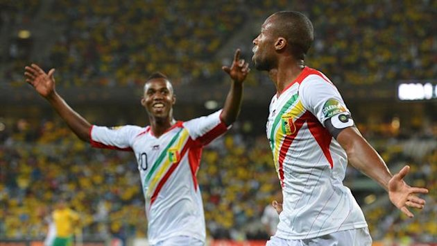 SOUTH AFRICA, Durban : Mali's midfielder Seydou Keita (R) celebrates after scoring a goal during the African Cup of Nation 2013 quarter final football match South-Africa vs Mali, on February 2, 2013 in Durban. AFP