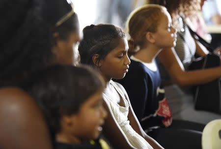 Children attend a church service for eight children who were killed in the Cairns suburb of Manoora