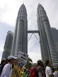 Anti-government protestors march past Malaysia's iconic Petronas twin towers as they proceed to Merdeka Square in Kuala Lumpur, on April 28. Thousands of protesters gathered in the Malaysian capital to demand electoral reforms, defying a lockdown of central Kuala Lumpur.