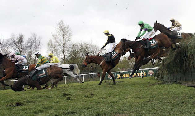 Synchronized ridden by Tony McCoy, left,  falls after jumping Becher&amp;#39;s Brook during the Grand National at Aintree Racecourse, Liverpool, England, Saturday April 14, 2012. Pre-race favorite Synchro