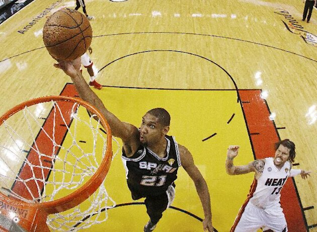 San Antonio Spurs power forward Tim Duncan (21) shoots against Miami Heat shooting guard Mike Miller (13) during the second half of Game 6 in the NBA Finals basketball series,  Wednesday, June 19, 201