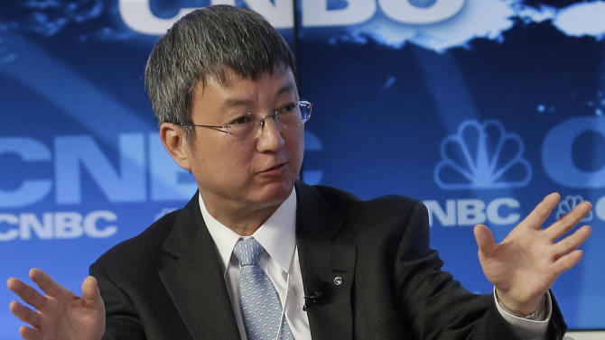 China's Min Zhu, Deputy Managing Director of the International Monetary Fund, speaks during the Global Financial Context session of the 43rd Annual Meeting of the World Economic Forum, WEF, in Davos, Switzerland, Wednesday, Jan. 23, 2013.  (AP Photo/Anja Niedringhaus)