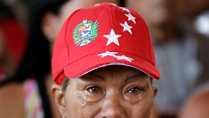 """A supporter of Venezuela's President Hugo Chavez wipes away tears as she prays for the ailing president at the military hospital's chapel in Caracas, Venezuela, Tuesday, March 5, 2013. A brief statement read on national television by Communications Minister Ernesto Villegas late Monday carried the sobering news about the charismatic 58-year-old leader's deteriorating health. Villegas said Chavez is suffering from """"a new, severe infection."""" The state news agency identified it as respiratory. (AP Photo/Ariana Cubillos)"""