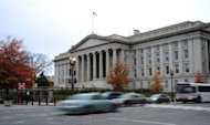 &lt;p&gt;Vehicles drive by the US Treasury Building in Washington on November 15, 2011. Treasury Secretary Timothy Geithner has warned the nation will reach its $16.39 trillion debt limit on December 31.&lt;/p&gt;