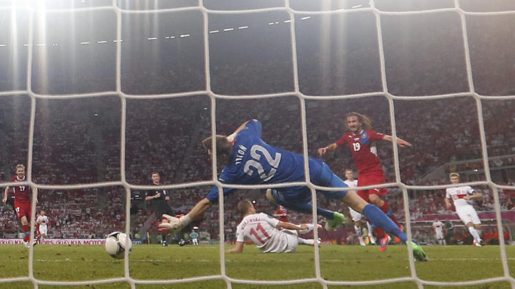 Czech Republic's Petr Jiracek scores by Poland goalkeeper Przemyslaw Tyton  during the Euro 2012 soccer championship Group A match between Czech Republic and Poland in Wroclaw, Poland, Saturday, June 16, 2012. (AP Photo/Jon Super)