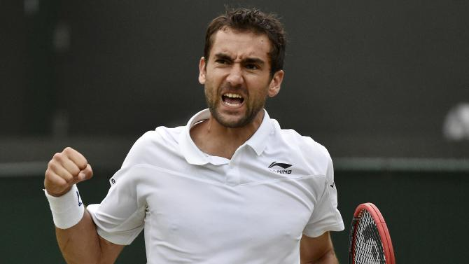 Marin Cilic of Croatia reacts during his match against John Isner of the U.S.A. at the Wimbledon Tennis Championships in London