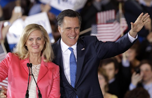 Republican presidential candidate, former Massachusetts Gov. Mitt Romney and his wife Ann wave to supporters at his Super Tuesday campaign rally in Boston, Tuesday night, March 6, 2012. (AP Photo/Step