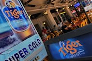<p>Tiger beer advertised in Singapore on September 28, 2012. F&N became a takeover target in September after selling off its most prized asset, Tiger Beer maker Asia Pacific Breweries to Heineken. A Thai billionaire has now been given another week to submit an improved bid for the Singapore conglomerate.</p>