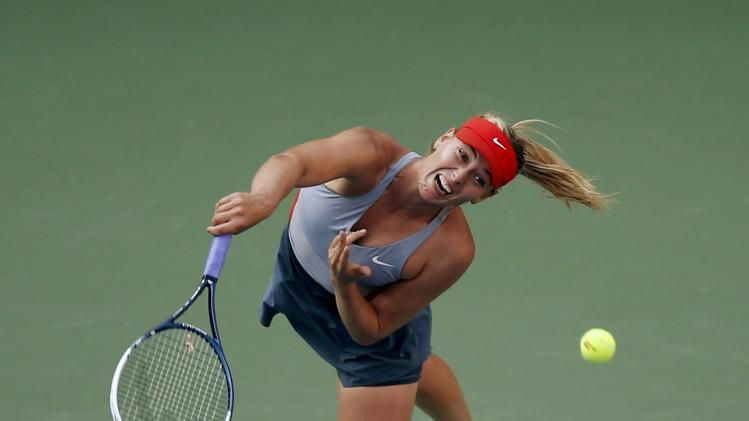 Maria Sharapova of Russia serves to Alexandra Dulgheru of Romania during their match at the 2014 U.S. Open tennis tournament in New York