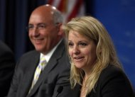 SpaceX President Gwynne Shotwell (R) speaks as NASA'S International Space Station Program Manager Mike Suffredini looks on during a news conference at the Kennedy Space Center in Cape Canaveral, Florida February 28, 2013. REUTERS/Scott Audette