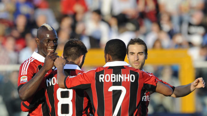 AC Milan's forward Mario Balotelli celebrates with his teammates after scoring  during Serie A soccer match between Pescara and AC Milan, at the Adriatico stadium in Pescara, Italy, Wednesday, May 8, 2013. (AP Photo/Sandro Perozzi)