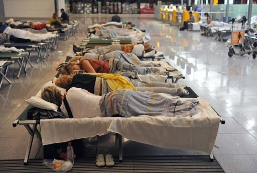 "<p>Flight passengers lay on camp beds at the ""Franz-Josef-Strauss"" airport in Munich, southern Germany. German airline Lufthansa announced it was cancelling two-thirds of Friday's flights, as a cabin staff union acted on its threat to call a 24-hour stoppage at German airports following earlier action.</p>"