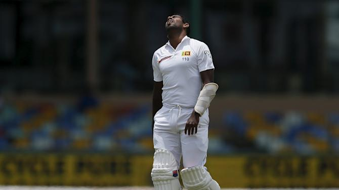 Sri Lanka's Prasad reacts after being injured during the third day of their third and final test cricket match against India in Colombo