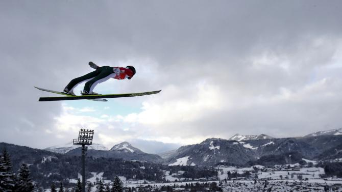 Koudelka from the Czech Republic soars through the air during the trial round for the first jumping of the 63rd four-hills ski jumping tournament in Oberstdorf