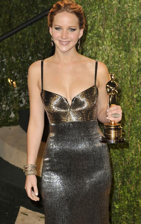 Jennifer showed off her Oscar in this form fitting, glitzy gown at the Vanity Fair Oscars after party. Copyright [rex]