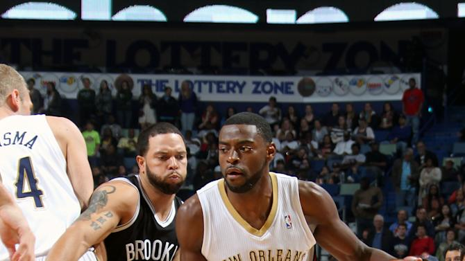 Evans, Morrow rally Pelicans past Nets in OT