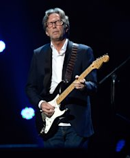 Eric Clapton performs at &quot;12-12-12&quot;, a concert benefiting The Robin Hood Relief Fund to aid the victims of Hurricane Sandy.