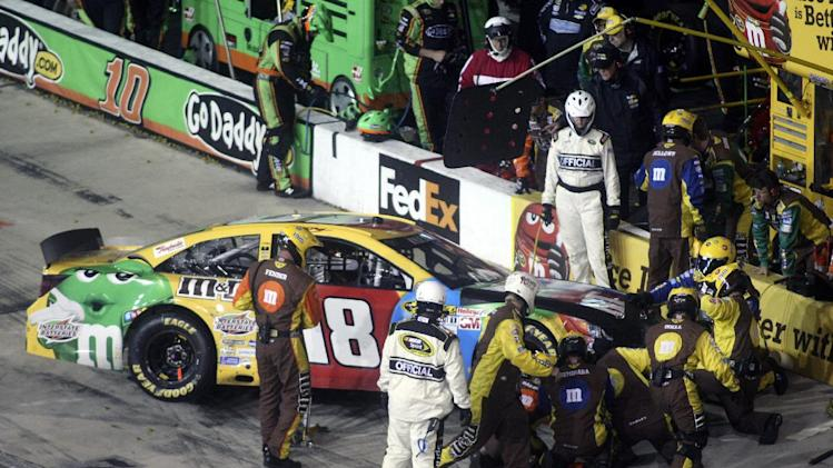 Kyle Busch pits his car after a wreck during the Toyota Owner's 400 NASCAR Sprint Cup series auto race at Richmond International Raceway in Richmond, Va., Saturday April 27, 2013.   (AP Photo/Jason Hirschfeld)
