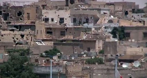 A UN image shows houses shelled in Homs