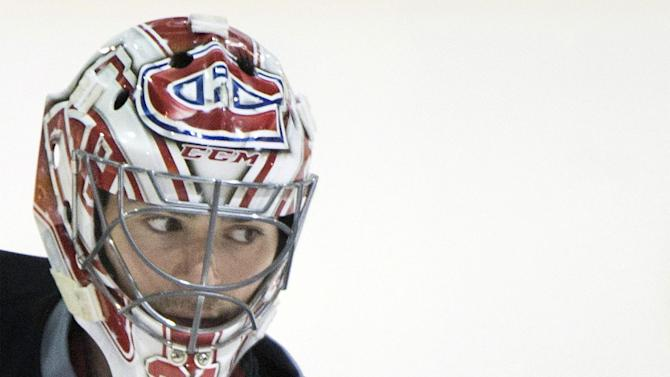 Monreal Canadiens' goaltender Carey Price looks down the ice during a practice session in Brossard, Quebec, Monday, April 21, 2014, ahead of game four of first-round NHL Stanley Cup playoff game against the Tampa Bay Lightning. The Canadiens lead the series 3-0