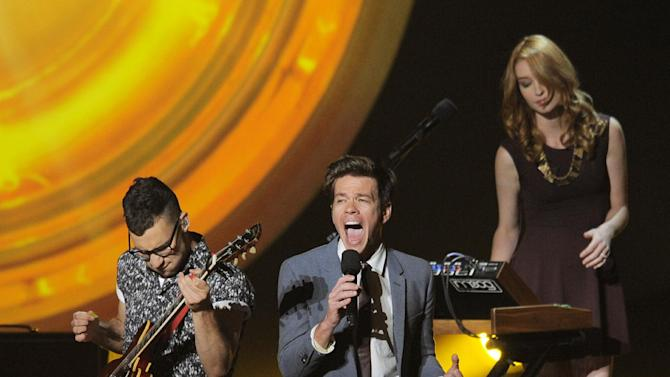 "FILE - In this Aug. 14, 2012 file photo, fun. members, from left, Jack Antonoff, Nate Ruess and Emily Moore perform onstage at the ""Teachers Rock"" concert at the Nokia Theatre, in Los Angeles. The band is up for six Grammy Awards, including the top four categories: album, song and record of the year, and best new artist. Their current tour wraps in Nashville, Tenn., on Feb. 16, 2013. (Photo by Chris Pizzello/Invision/AP, File)"