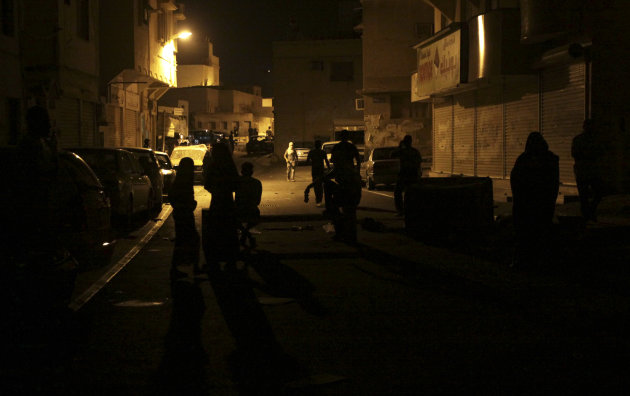 Anti-government protesters wait in a street as clashes with riot police break out in the neighborhood late Wednesday, Sept. 7, 2011, in Daih, Bahrain, on the outskirts of the capital of Manama. Riot p