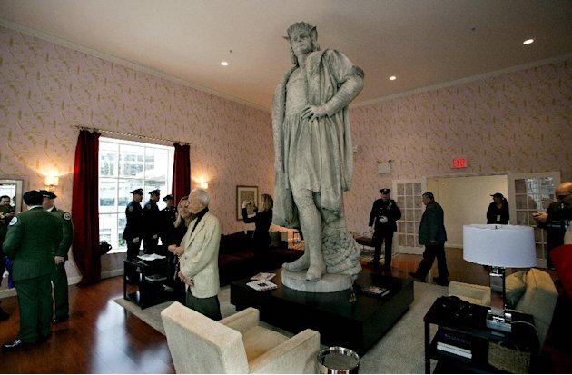 Leaders of the Italian-American community, civil servants from New York, including police and sanitation workers and other guests, stand in what is known as the living room created by artist Tatzu Nis